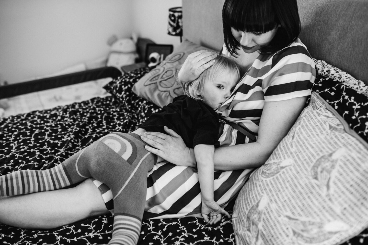Mother breastfeeding a toddler