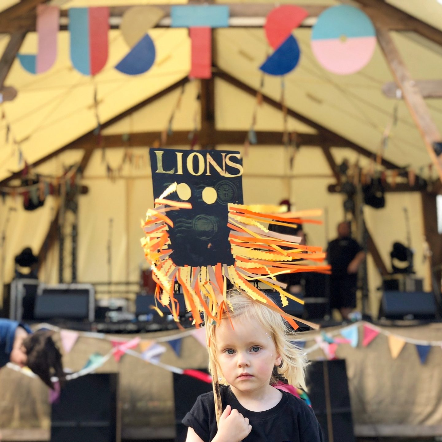 Just So Festival 2018 review and our top tips for Just So Festival - 3 year old with lion sign