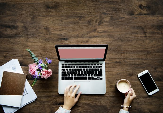 Flowers, laptop and cup of coffee