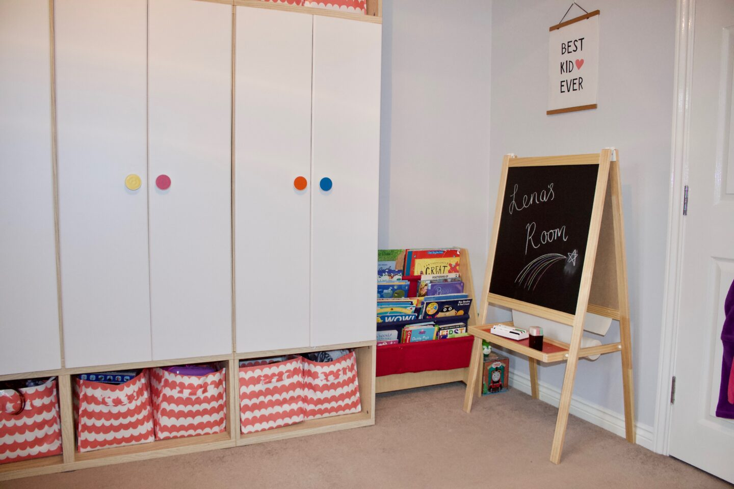 A child's bedroom with a bookshelf and an art easel