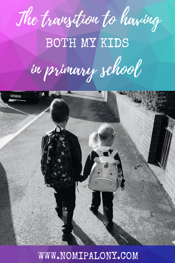 Two children walking to school together holding hands
