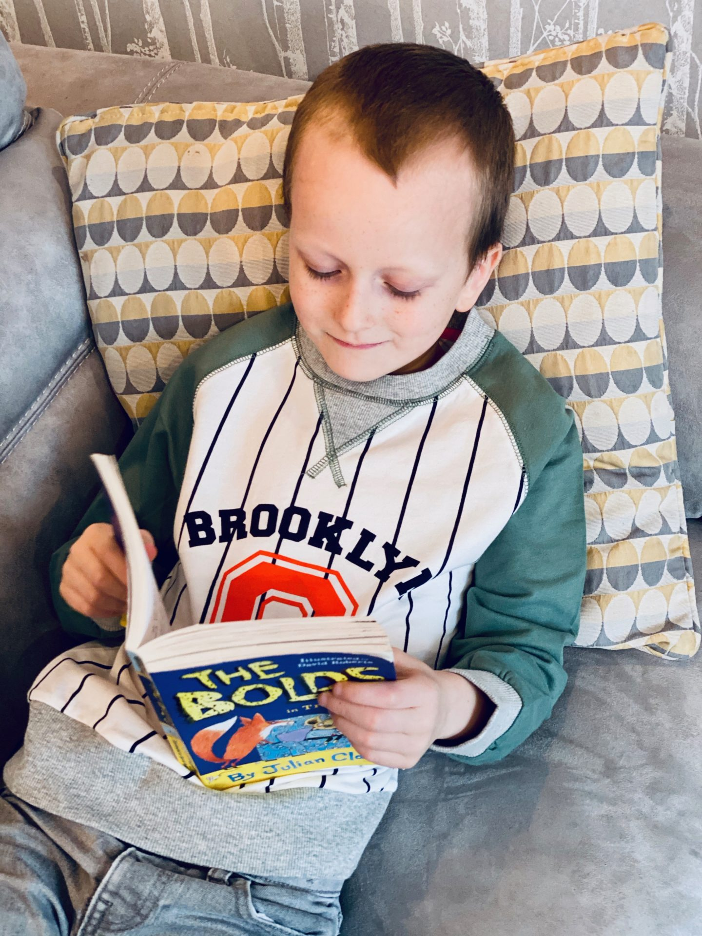 Letter to my first born on his 8th birthday - boy reading book
