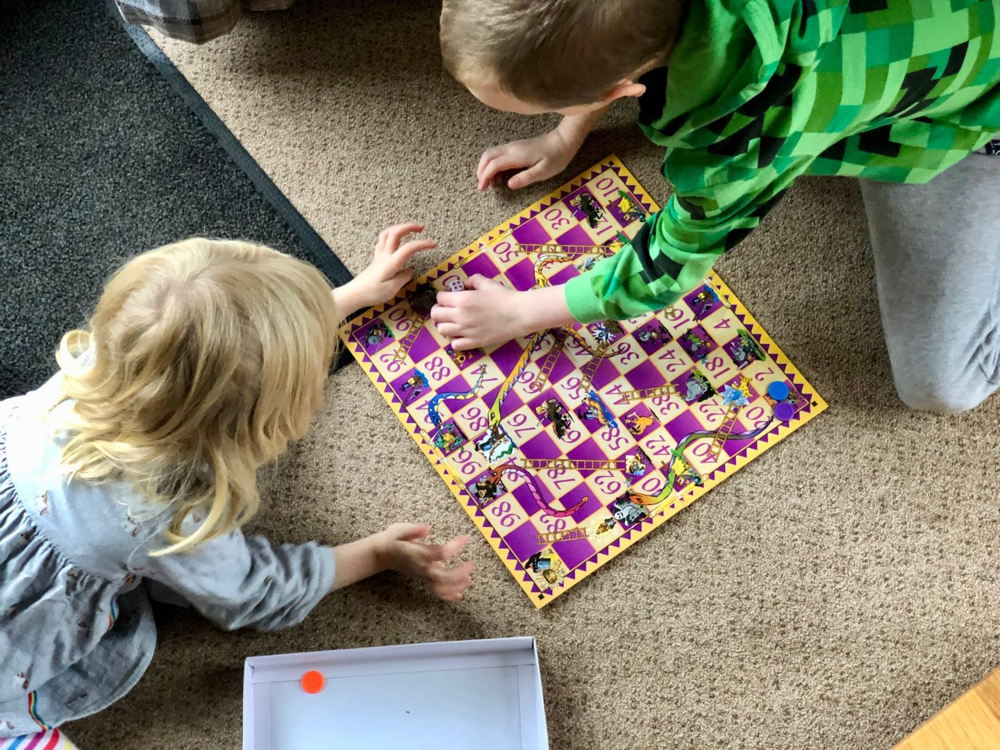 AD: Landal Sandybrook Peak District family review - a relaxing autumnal long weekend break. Kids playing snakes and ladders.