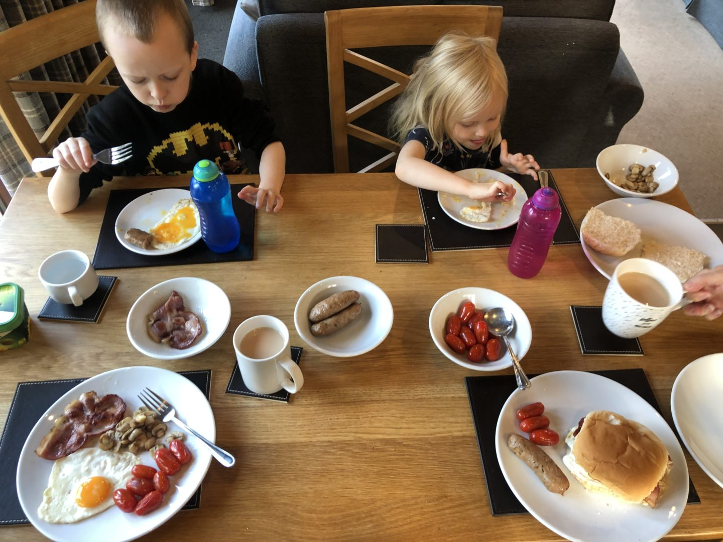 AD: Landal Sandybrook Peak District family review - a relaxing autumnal long weekend break. Kids eating breakfast in the lodge.