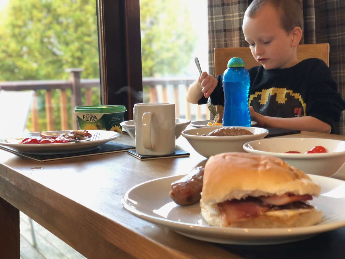 AD: Landal Sandybrook Peak District family review - a relaxing autumnal long weekend break. My son eating his breakfast in the kitchen.