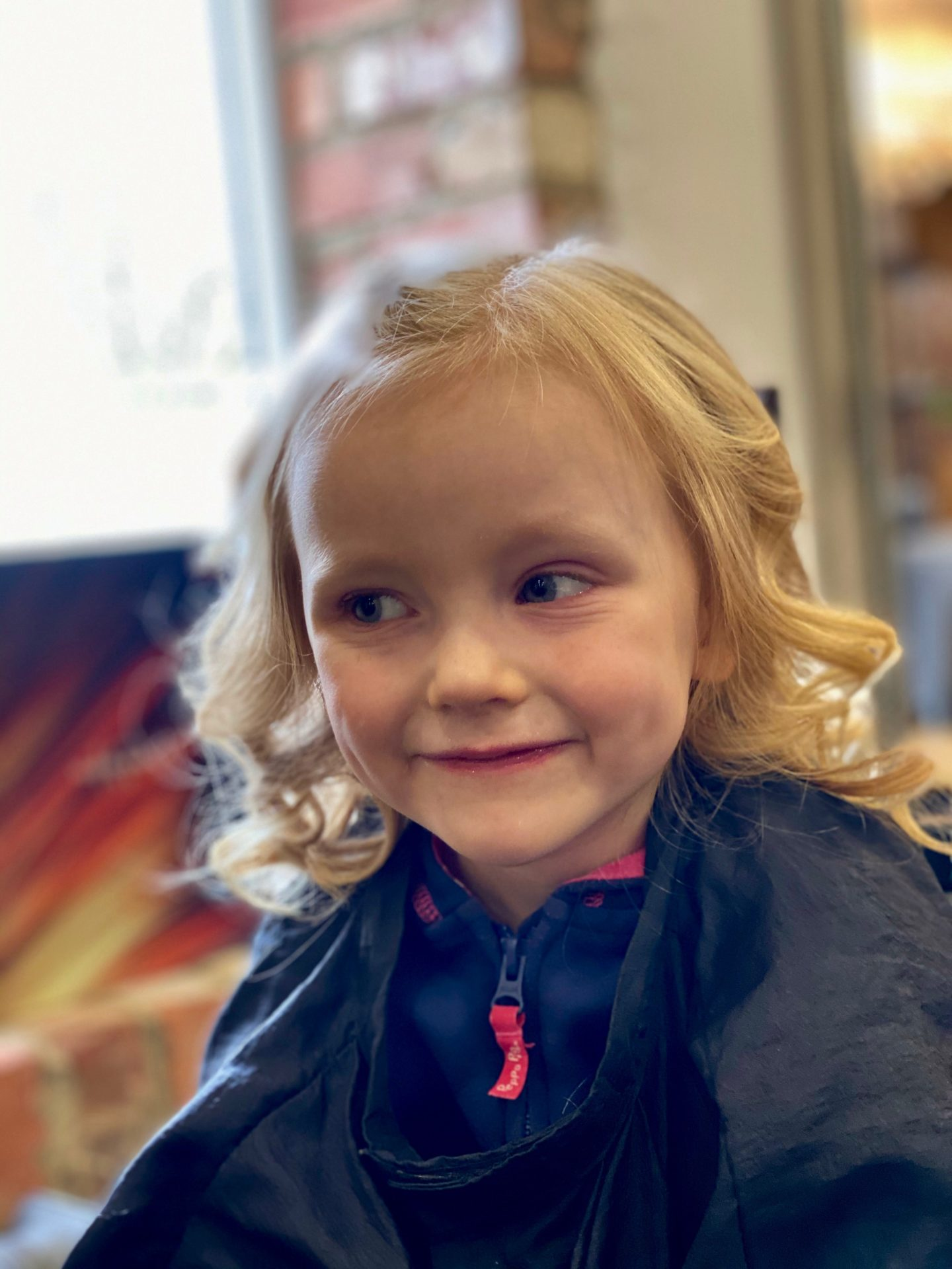 Letters to Lena - on your 5th birthday: 4 year old in hair salon smiling