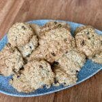 Dairy free cinnamon and raisin oatmeal cookies on a plate.