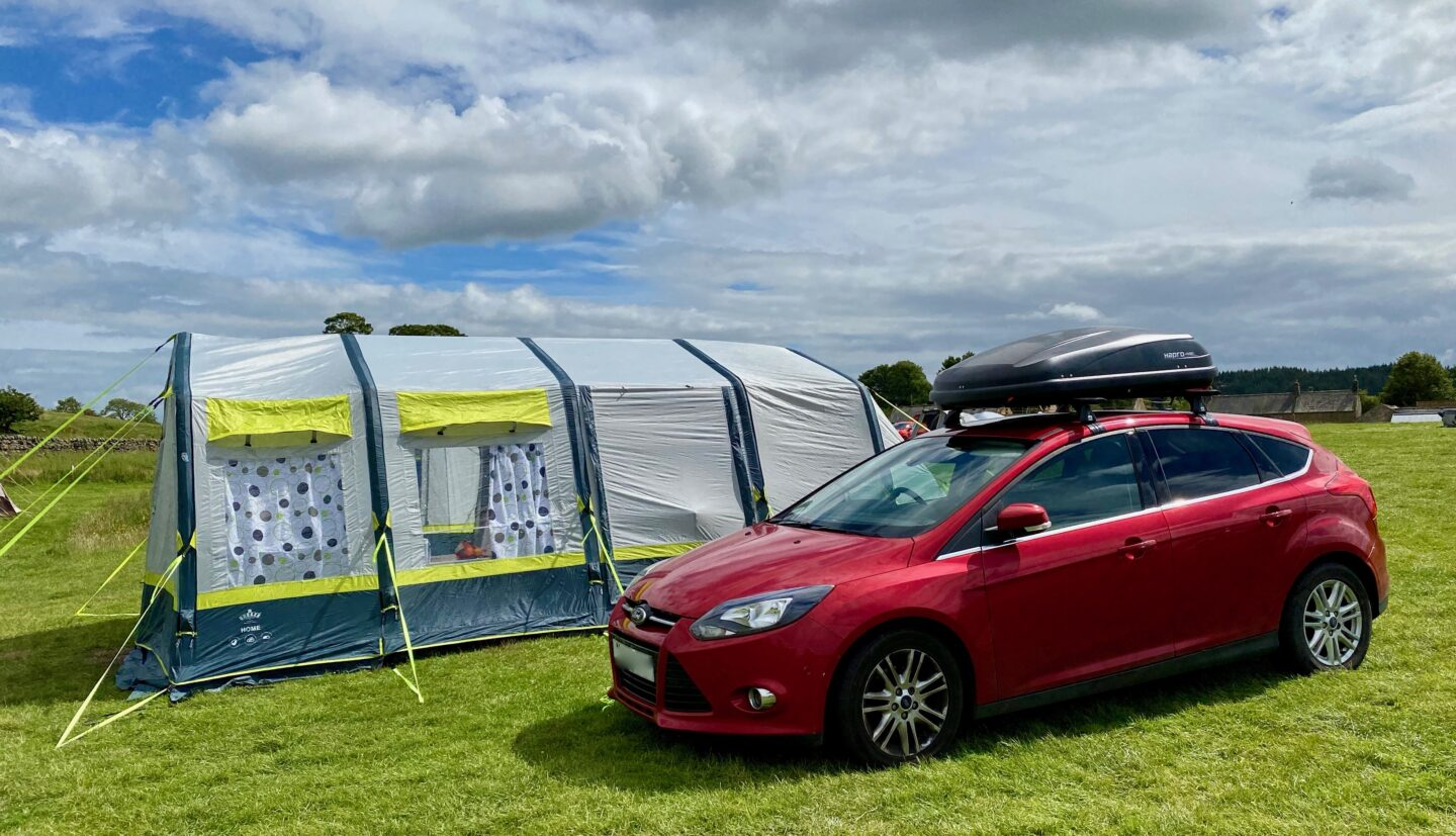 The OLPRO Home tent next to a Ford Focus