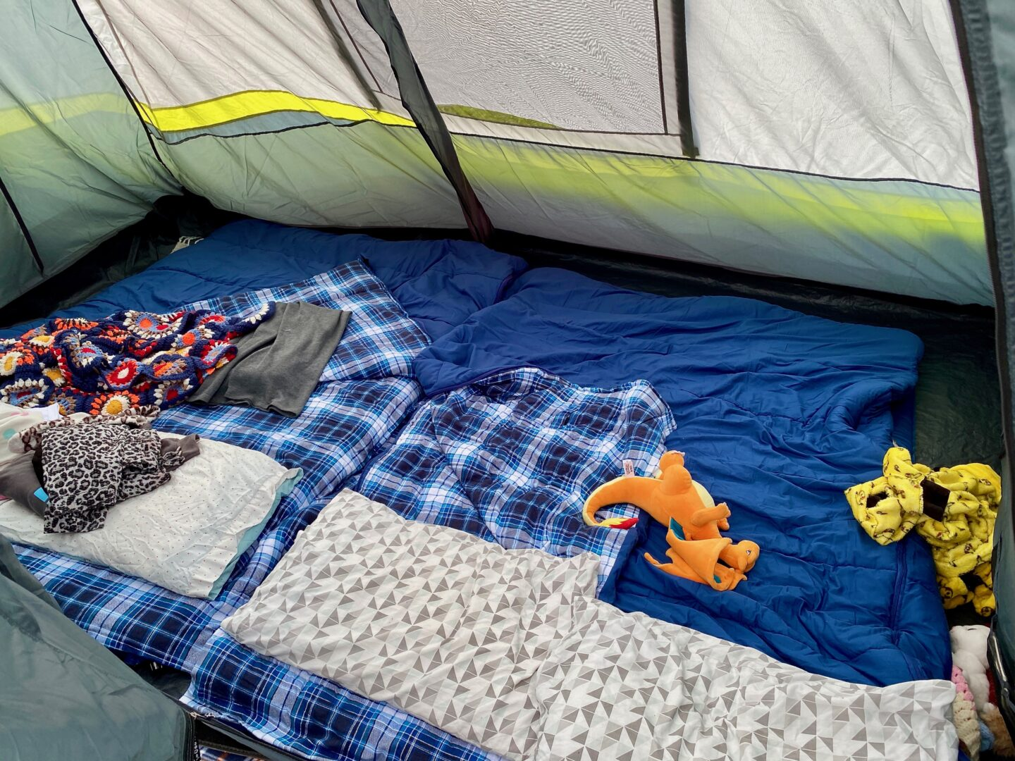 Bedroom set up of the tent with two double SIMS with two double sleeping bags and 4 pillows with room to spare.