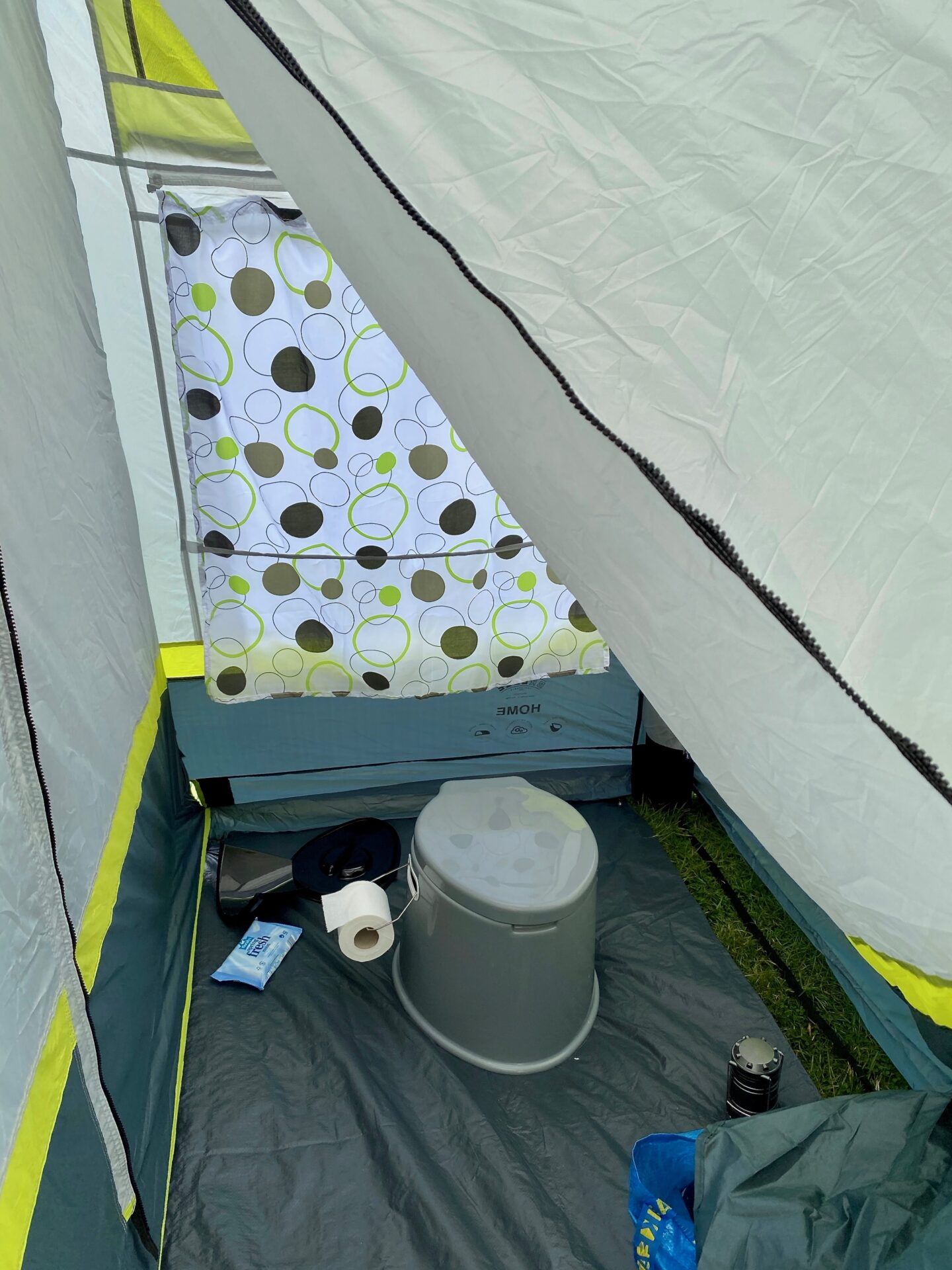 Toilet area of the porch - it's spacious with a toilet, toiler roll, wipes and a lamp set up.