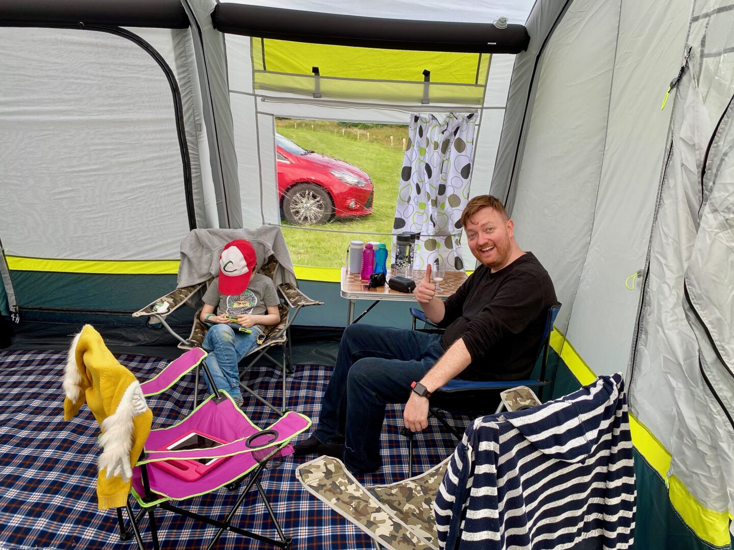 A father and son relaxing in the OLPRO Home tent