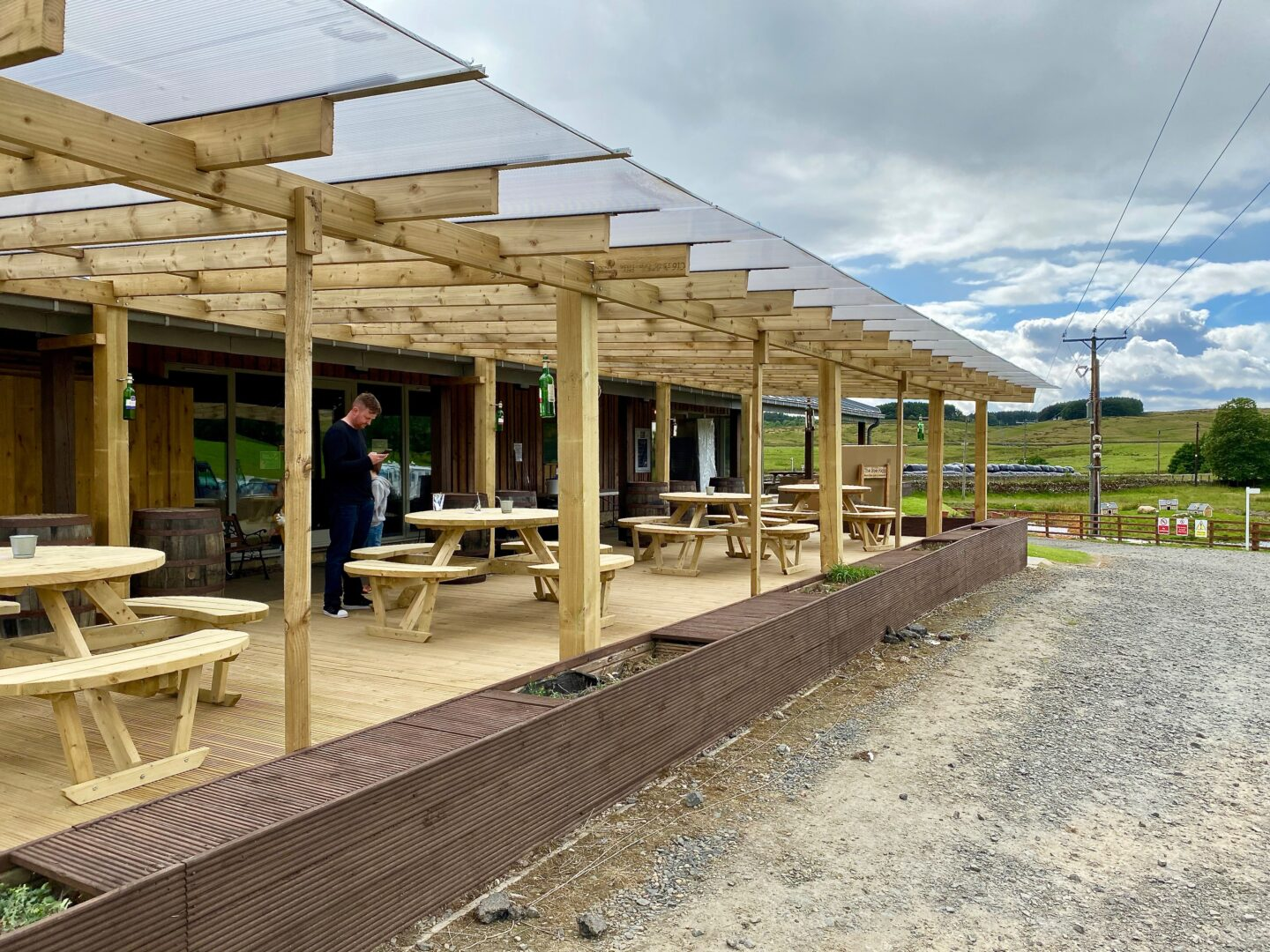 Outdoor seating at the Boe Rigg restaurant - 4 picnic tables under a pergola