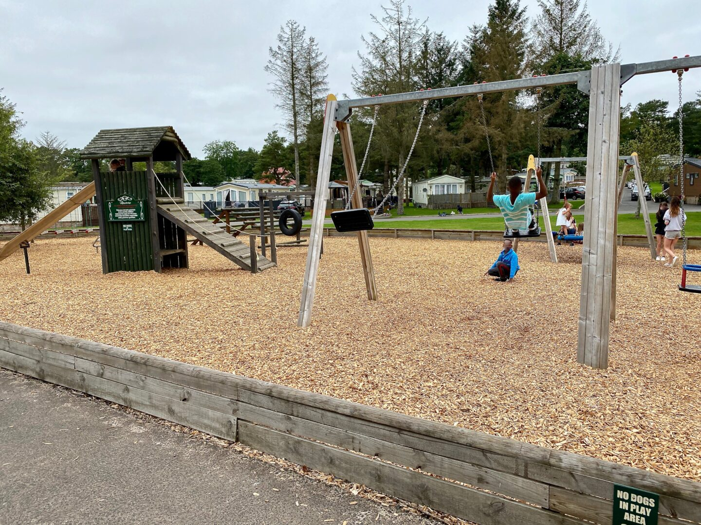 Children playing on swings in a play park