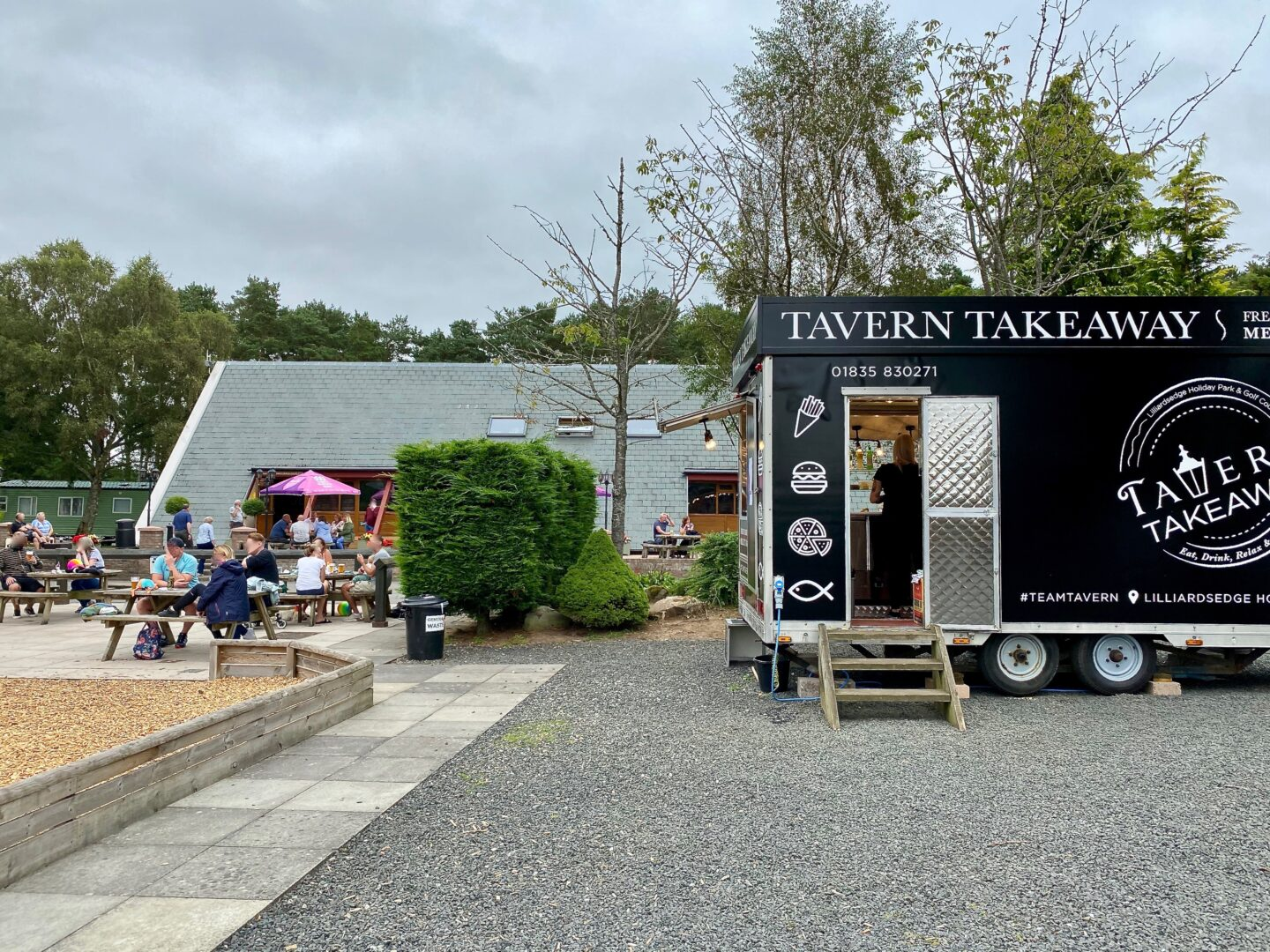 A takeaway truck and picnic tables