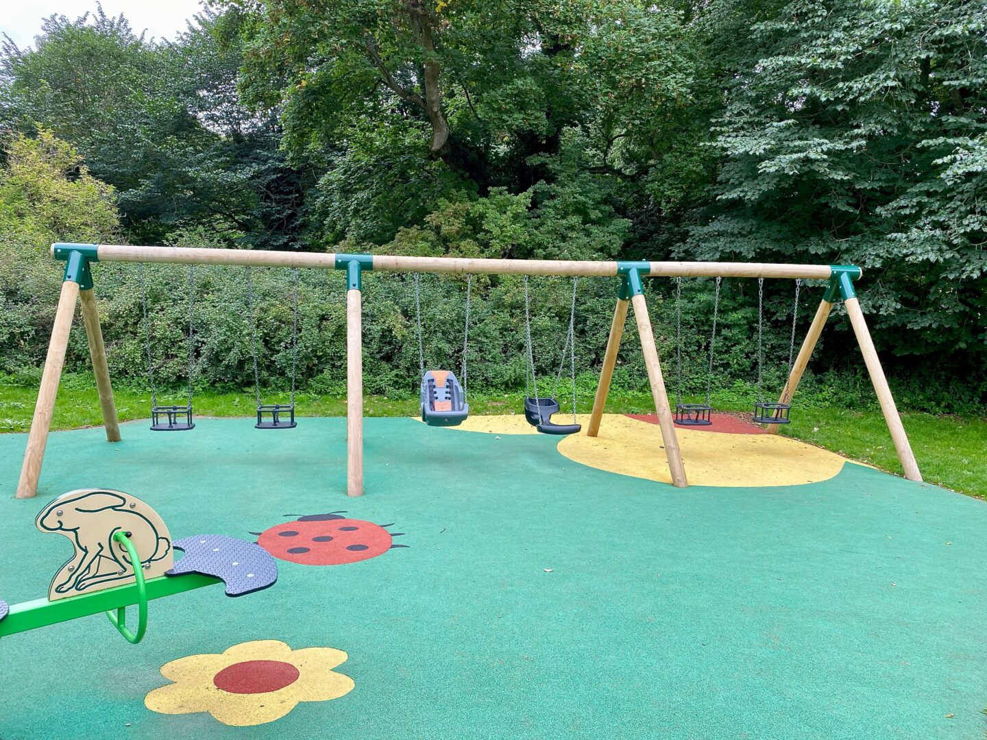 A swingset showing some accessible seating