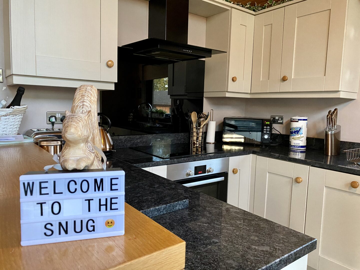 Kitchen with a small sign that says welcome to the snug