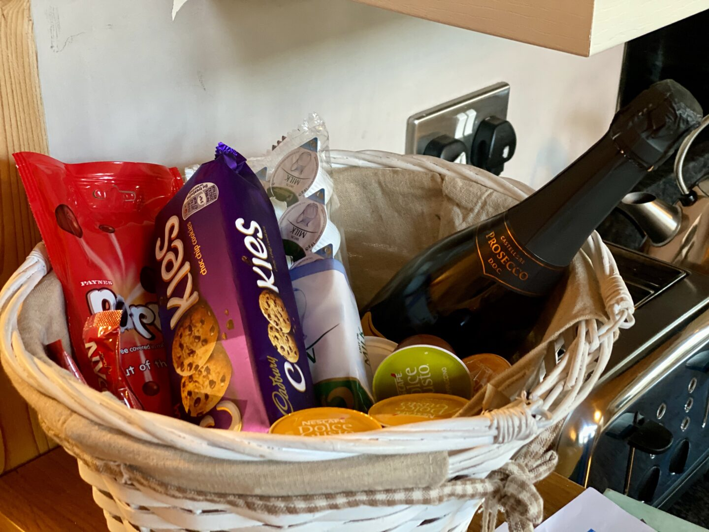 Welcome basket at the Snug with cookies, chocolate, prosecco and teas, coffees etc