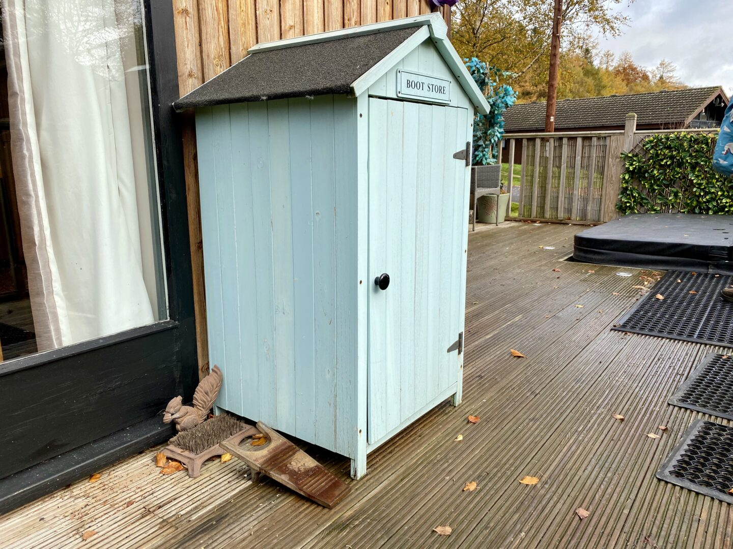 A little outdoor cupboard for wellies at the Snug