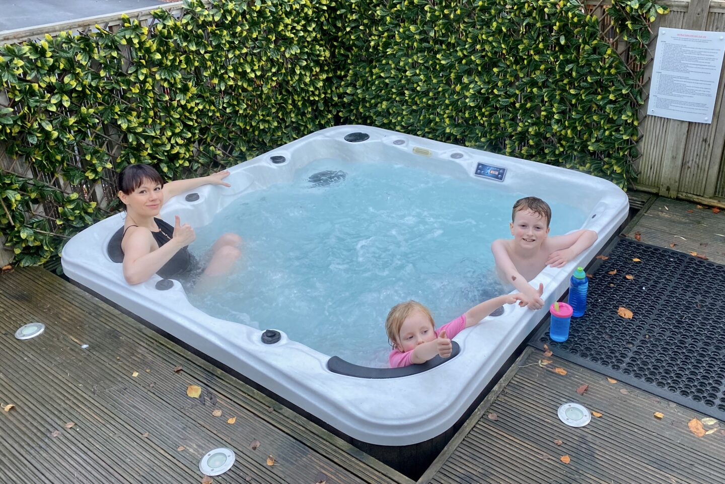 Woman and two children in the hot tub