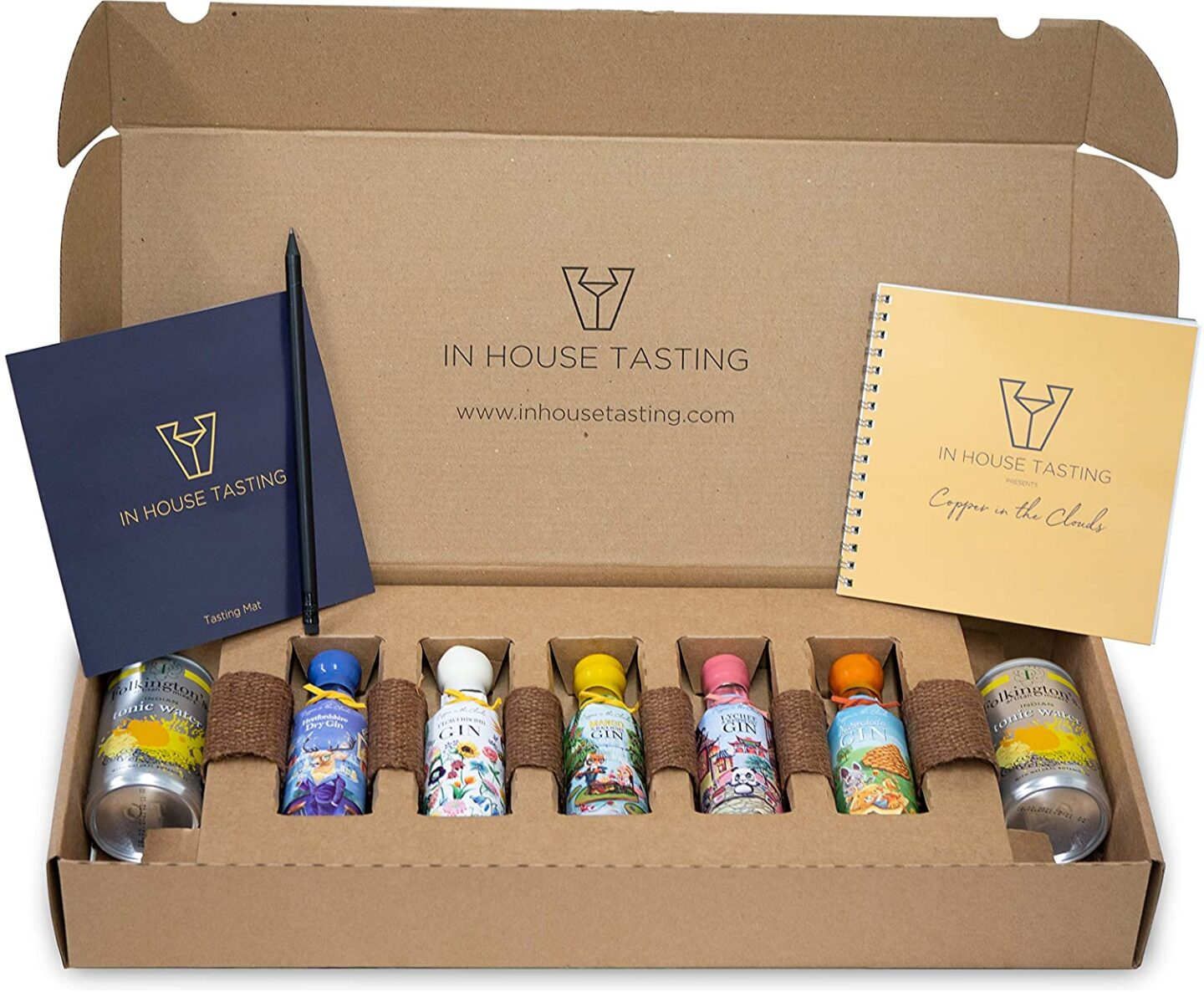 A box containing a gin tasting kit - small gin samples and mixers