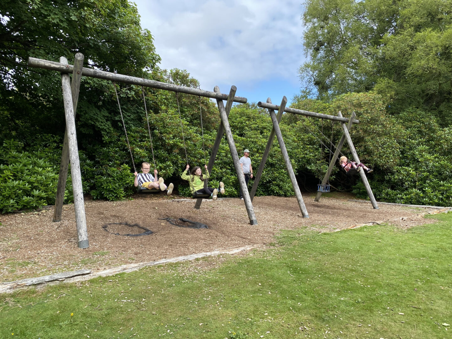 Children playing on the swings at Crombie Park