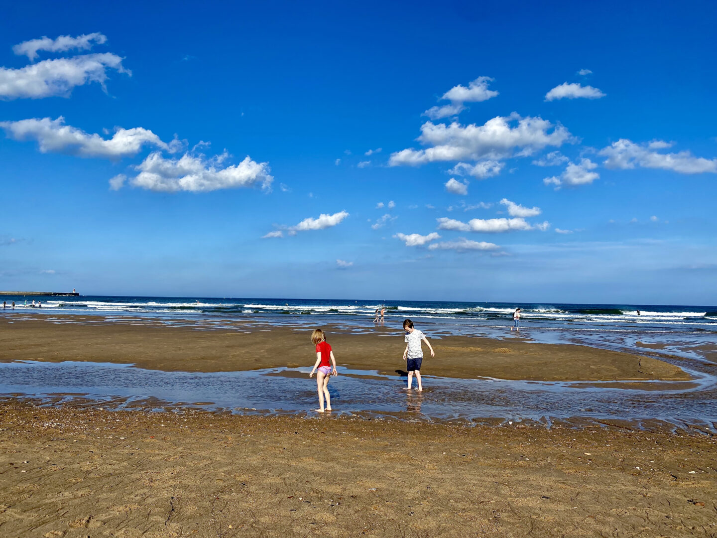 2 children playing on a beach